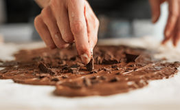 Professional confectioner making tasty cake with melted chocolat Royalty Free Stock Photo