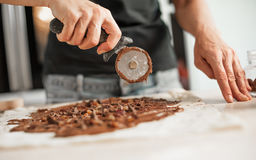 Professional confectioner making tasty cake with melted chocolat Stock Image
