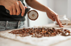 Professional confectioner making tasty cake with melted chocolat Stock Images