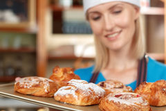 Professional confectioner working in the kitchen Stock Images
