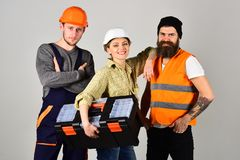 Professional and confident. Constructing engineers or architects. Professional working team. Construction technicians. With building tools. Men and girl stock photography