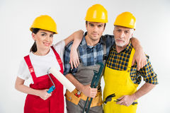 Professional construction workers. Holding tools and looking at camera stock photo