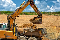 Professional construction working with excavator Stock Images