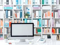 Professional contemporary workspace with computer. Supplies and colorful folders on the background Royalty Free Stock Images