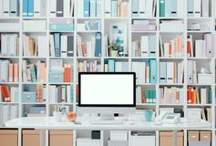 Professional contemporary workspace with computer. Supplies and colorful folders on the background Stock Image