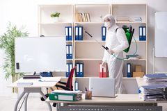 The professional contractor doing pest control at office stock photos