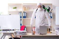 The professional contractor doing pest control at office royalty free stock photo
