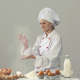 Professional cook baking. Woman cook at the kitchen Royalty Free Stock Image