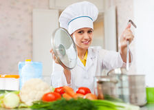 Professional cook  in her kitchen Royalty Free Stock Image