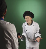 Professional cook scolding a cooworker Stock Image