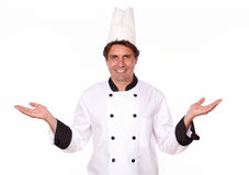 Professional cook standing with palms out Royalty Free Stock Image