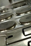 Professional cooking range. A professional cooking range in an industrial kitchen Stock Photography