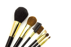 Professional cosmetic brushes for makeup on white background. Royalty Free Stock Photography