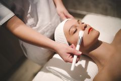 Cosmetic and massage treatment at wellbeing saloon. Professional cosmetic and massage treatment at wellbeing saloon Stock Photography