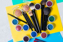 Professional cosmetics on a bright yellow background, top view, close-up, visage stock image