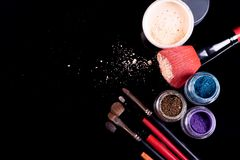 Professional cosmetics and brushes for make-up on a black background.  stock images