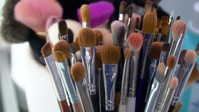 Professional cosmetics makeup brushes kit in motion stock footage