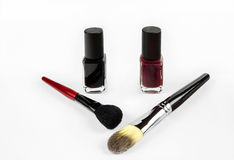 Professional cosmetics nail polish and makeup  brushes. Professional cosmetics nail polish and brush isolation Royalty Free Stock Image