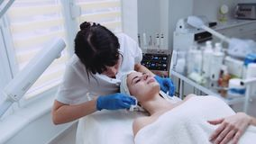 Professional cosmetologist cleaning the patient's face off the organic beauty mask. Skincare, vitality. Healthy. Professional cosmetologist cleaning the stock video