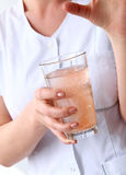 Professional. Cosmetologist with glass of water Stock Photo