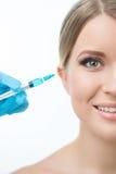 Professional cosmetologist making beauty injections Stock Photo