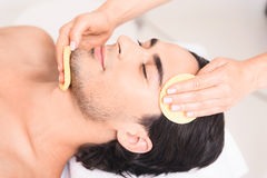 Professional cosmetologist making facial treatment Royalty Free Stock Photography