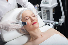 Professional cosmetologist is undergoing cavitation therapy Stock Photography
