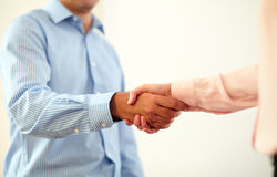 Professional couple coworker giving hands greeting Royalty Free Stock Photography