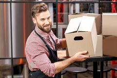 Professional courier with boxes stock photos