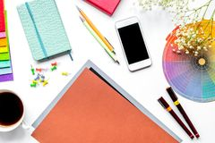 Professional creative graphic designer desk on white background. Professional creative graphic designer desk with tools, mobile and cup on white background top royalty free stock image