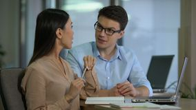 Professional crisis managers discussing company promotion strategy writing plan. Stock footage stock video footage