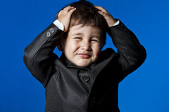 Professional, cute little boy portrait over blue chroma backgrou. Businessman, cute little boy portrait over blue chroma background Stock Photography