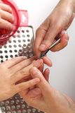 Professional cuticle removing Stock Photos