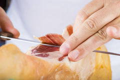 Professional cutting of serrano ham Stock Photo