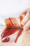 Professional cutting of serrano ham Royalty Free Stock Image