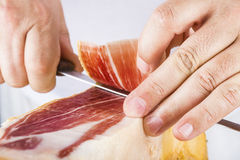 Professional cutting of serrano ham Stock Photography