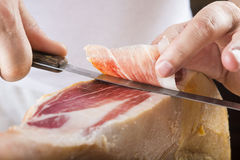 Professional cutting of serrano ham Royalty Free Stock Photos