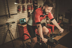 Professional cyclist being tested on body geometry simulator in fit services. royalty free stock photos