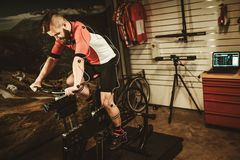 Professional cyclist being tested on body geometry simulator in fit  services. Stock Photo
