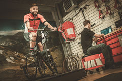 Professional cyclist being tested on body geometry simulator in fit  services. Stock Images