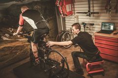 Professional cyclist being tested on body geometry simulator in fit services. stock image