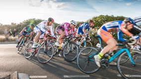 Professional cyclist in a corner at full speed Royalty Free Stock Photos