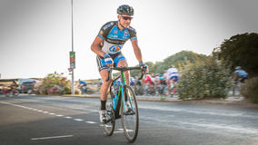 Professional cyclist injured during a race Royalty Free Stock Photography