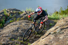 Professional Cyclist Riding the Bike on Beautiful Spring Mountain Trail. Extreme Sports Stock Photography