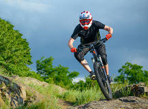 Professional Cyclist Riding the Bike on Beautiful Spring Mountain Trail. Extreme Sports Royalty Free Stock Photo
