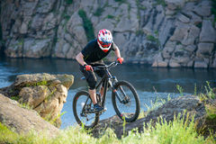 Professional Cyclist Riding the Bike on Beautiful Spring Mountain Trail. Extreme Sports Stock Image