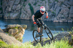 Professional Cyclist Riding the Bike on Beautiful Spring Mountain Trail. Extreme Sports Stock Images