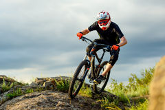Professional Cyclist Riding the Bike on the Rocky Trail. Extreme Sport. Royalty Free Stock Image