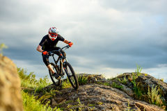 Professional Cyclist Riding the Bike on the Rocky Trail. Extreme Sport. Stock Photos