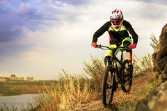 Professional Cyclist Riding the Bike at the Rocky Trail. Extreme Sport Concept. Space for Text. Royalty Free Stock Images